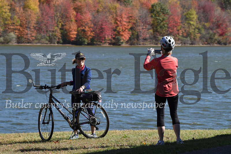 Picture Perfect Day!Harold Aughton/Butler Eagle: Clare Torso of Slippery Rock, a retired seneca valley school teacher, takes a photo of her friend, Patti Day of Zelienople, a retired nurse, at Lake Arthur, Monday, Oct. 21.