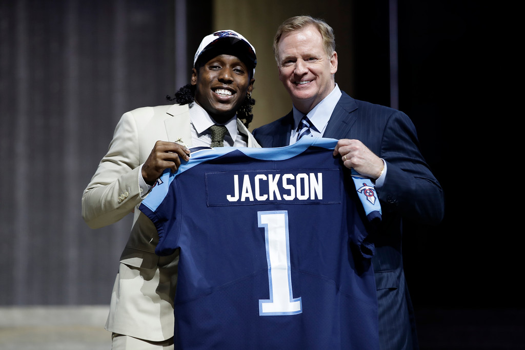 . Southern California\'s Adoree\' Jackson, left, poses with NFL commissioner Roger Goodell after being selected by the Tennessee Titans during the first round of the 2017 NFL football draft, Thursday, April 27, 2017, in Philadelphia. (AP Photo/Matt Rourke)