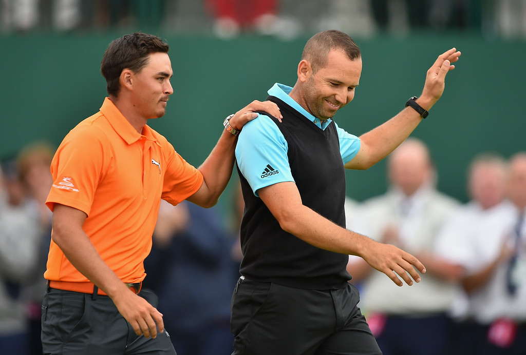 . Sergio Garcia of Spain and Rickie Fowler of the United States (L) walk across the 18th green after the final round of The 143rd Open Championship at Royal Liverpool on July 20, 2014 in Hoylake, England.  (Photo by Stuart Franklin/Getty Images)