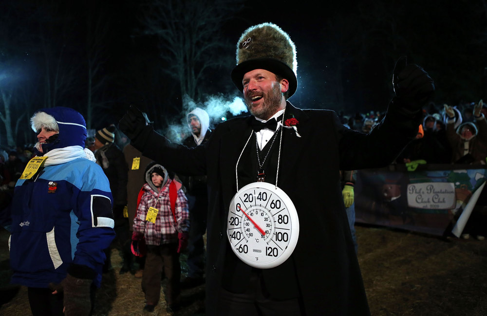 Description of . 'Big Chill' Jason Grusky, a member of the Punxsutawney 'Inner Circle,' gestures during the 127th Groundhog Day Celebration at Gobbler's Knob on February 2, 2013 in Punxsutawney, Pennsylvania. Thousands of people gathered at the event to watch Punxsutawney Phil's annual forecast.  (Photo by Alex Wong/Getty Images)