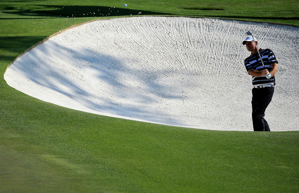 . Thomas Bjorn of Denmark hits out of the bunker on the 11th hole during the third round of the 2014 Masters Tournament at Augusta National Golf Club on April 12, 2014 in Augusta, Georgia.  (Photo by David Cannon/Getty Images)