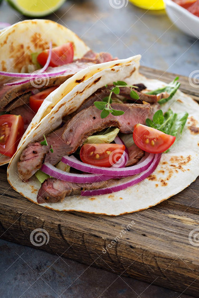 //www.dreamstime.com/royalty-free-stock-images-steak-tacos-sliced-meet-salad-tomato-salsa-cutting-board-image75540189