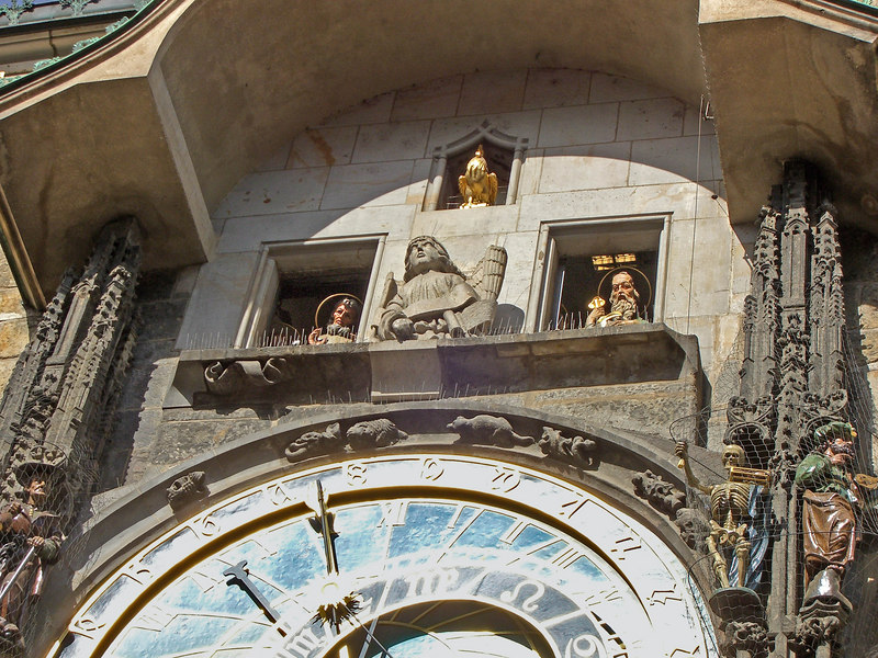Astronomical clock: Christ and the 12 Apostles come out at the striking of the hour (top windows). Skeleton of Death at lower right corner with bell and hourglass.