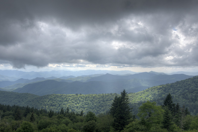 Sunlight breaks through the heavy clouds on the Blue Ridge Parkway in North Carolina on Friday, July 24, 2015. Copyright 2015 Jason Barnette