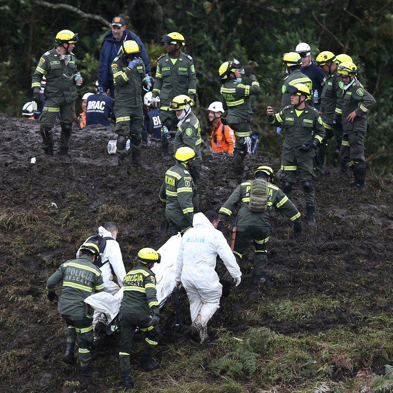 . Rescue workers remove the body of a victim of an airplane crash in La Union, near Medellin, Colombia, Tuesday, Nov. 29, 2016. The plane was carrying the Brazilian first division soccer club Chapecoense team that was on it\'s way for a Copa Sudamericana final match against Colombia\'s Atletico Nacional. (AP Photo/Fernando Vergara)
