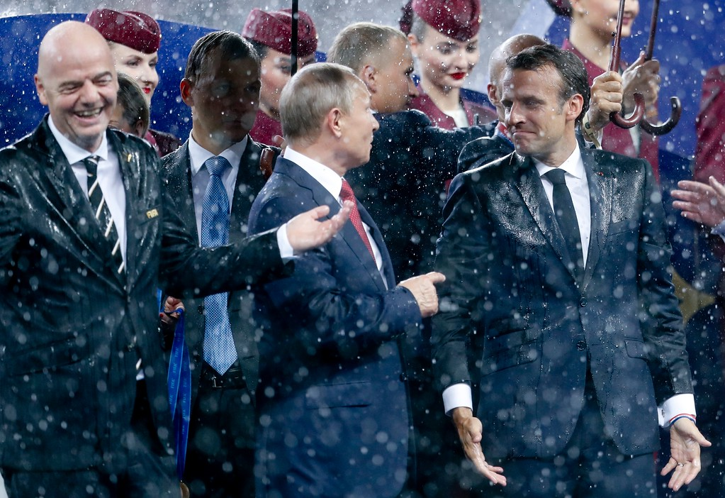 . French President Emmanuel Macron, right, Russian President Vladimir Putin, center, and FIFA President Gianni Infantino at the end of the final match between France and Croatia at the 2018 soccer World Cup in the Luzhniki Stadium in Moscow, Russia, Sunday, July 15, 2018. France won 4-2. (AP Photo/Petr David Josek)