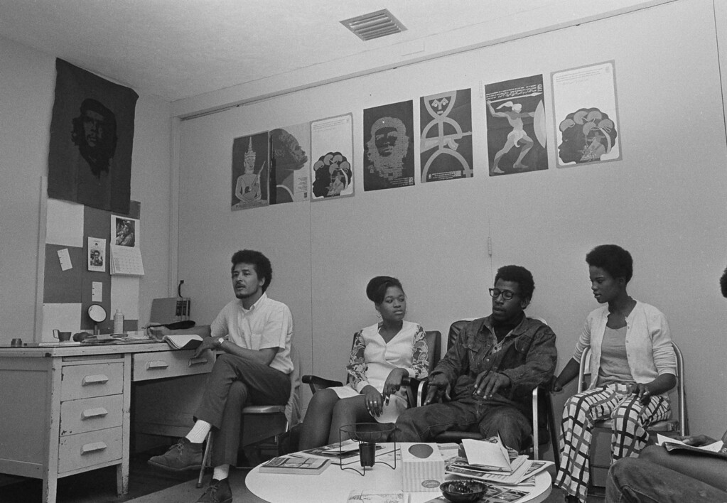 . Members of the Black Afro Militant Movement gather in a meeting room decorated with posters of Che Guevara in Miami, Fla., Jan. 30, 1970. From left: In\'Siri, Sister Faye, Chairman Cetewayo and Sister Lenora. BAMM has just recently organized in Miami.  (AP Photo/Jim Bourdier)