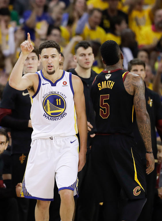 . Golden State Warriors guard Klay Thompson (11) gestures after scoring against the Cleveland Cavaliers during the second half of Game 1 of basketball\'s NBA Finals in Oakland, Calif., Thursday, May 31, 2018. (AP Photo/Marcio Jose Sanchez)