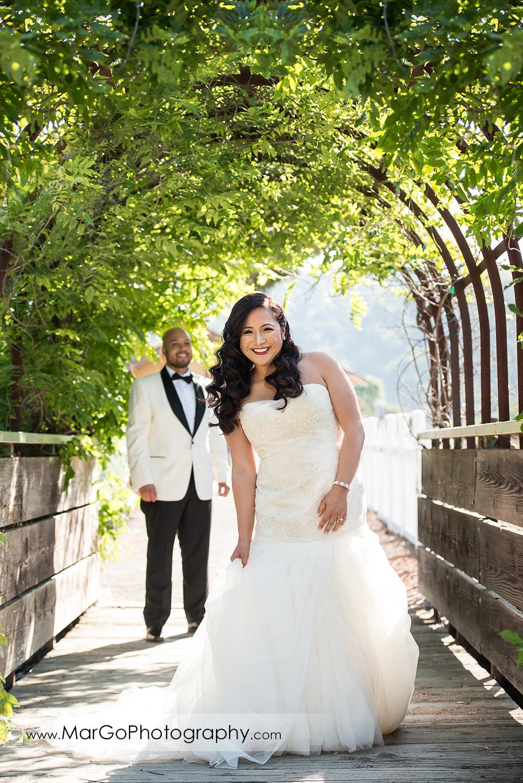 groom approaching bride during first look near Sunol's Casa Bella