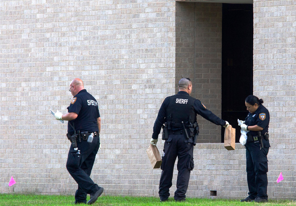 . Police collect evidence after a shooting happened on Lone Star College North Harris campus on Tuesday January 22, in Houston. The shooting at a community college wounded three people Tuesday and sent some students fleeing for safety while others with medical training helped tend the wounded.   (AP Photo/ Patric Schneider)