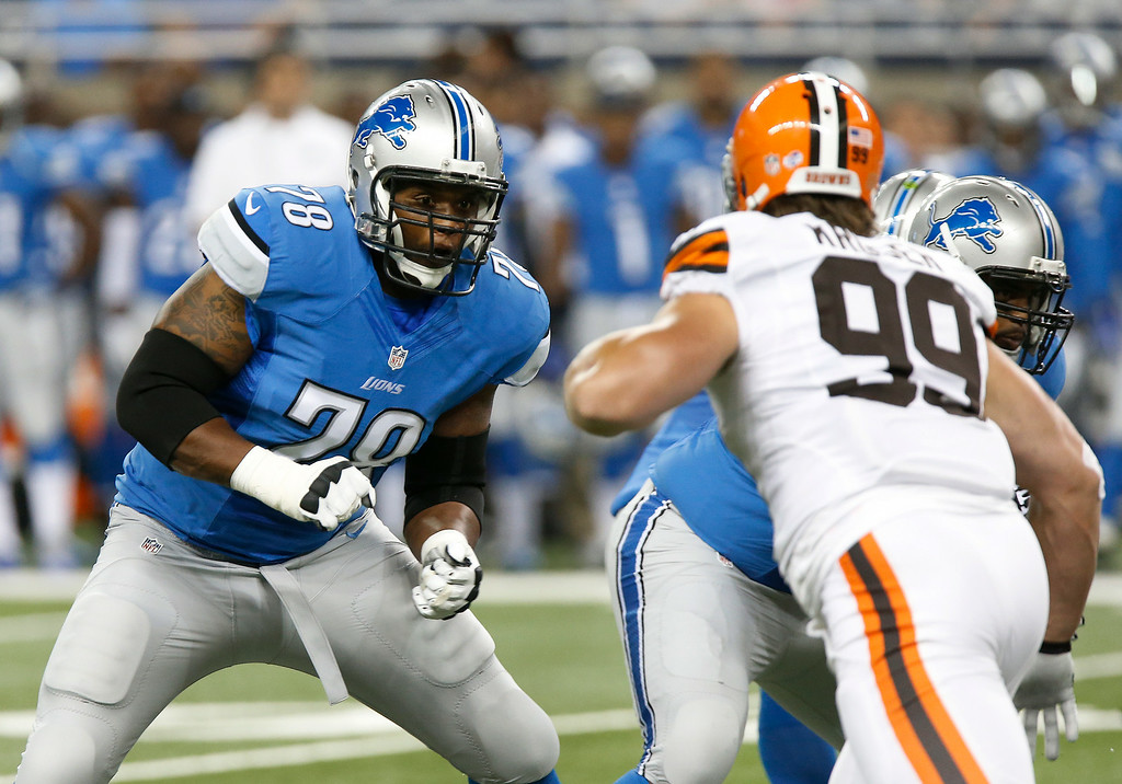 . Detroit Lions tackle Corey Hilliard (78) blocks Cleveland Browns outside linebacker Paul Kruger (99) in the first half of a preseason NFL football game at Ford Field in Detroit, Saturday, Aug. 9, 2014.  (AP Photo/Duane Burleson)