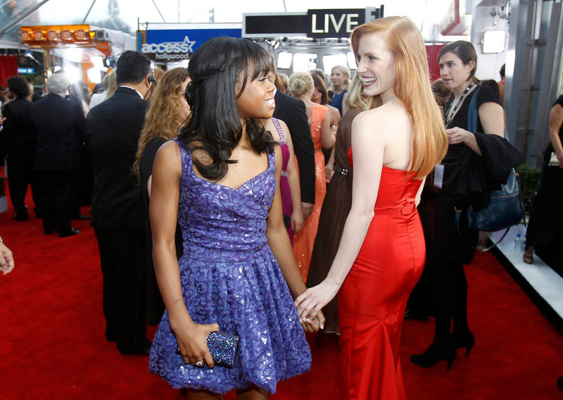 . Olympic gymnast Gabby Douglas (L) and actress Jessica Chastain arrive at the 19th annual Screen Actors Guild Awards in Los Angeles, California January 27, 2013.   REUTERS/Mario Anzuoni