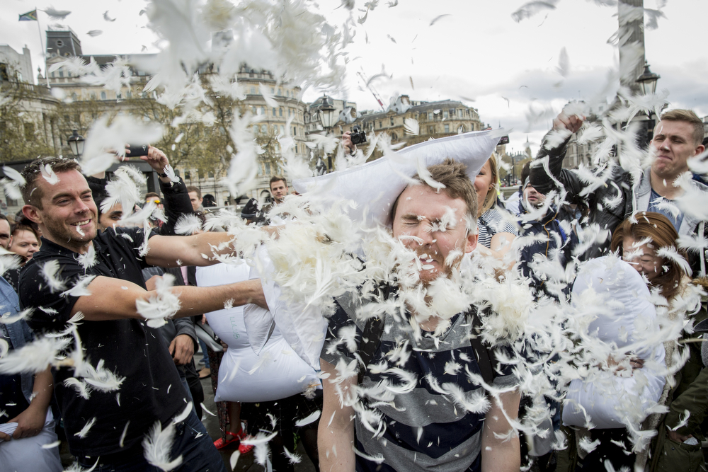 . Revelers take part in a giant pillow fight on the north terrace of Trafalgar Square on \'International Pillow Fight Day\' on April 5, 2014 in London, England.  Pillow fights have been organized numerous other cities around the world simultaneously.  (Photo by Rob Stothard/Getty Images)