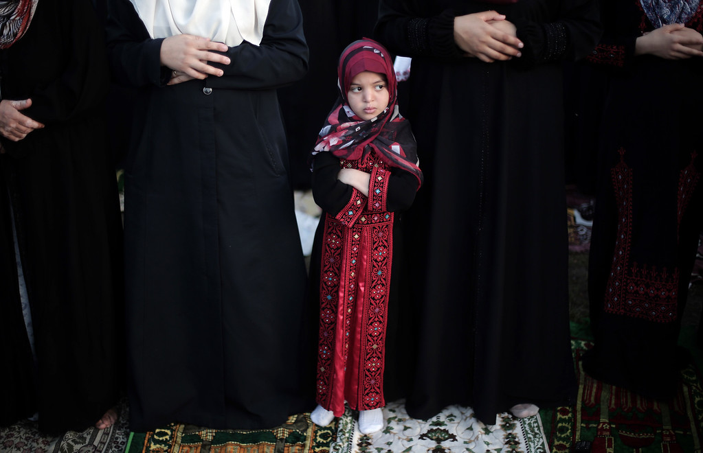 . Palestinian Muslims pray to mark the first day of Eid al-Adha (Feast of the Sacrifice), in Gaza City, Monday, Sept. 12, 2016. Muslims around the world celebrate Eid al-Adha by sacrificing animals to commemorate the prophet Ibrahim\'s faith in being willing to sacrifice his son. (AP Photo/ Khalil Hamra)