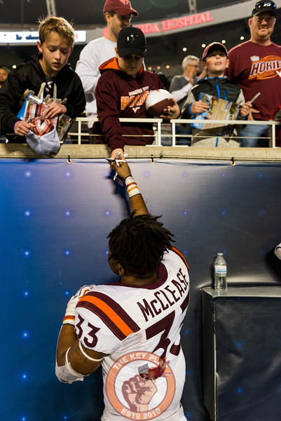 Deshawn McClease hands a young fan his glove after the Camping World Bowl between Virginia Tech and Oklahoma State in Orlando, Fl., Thursday, Dec. 28, 2017. (Special by Cory Hancock)