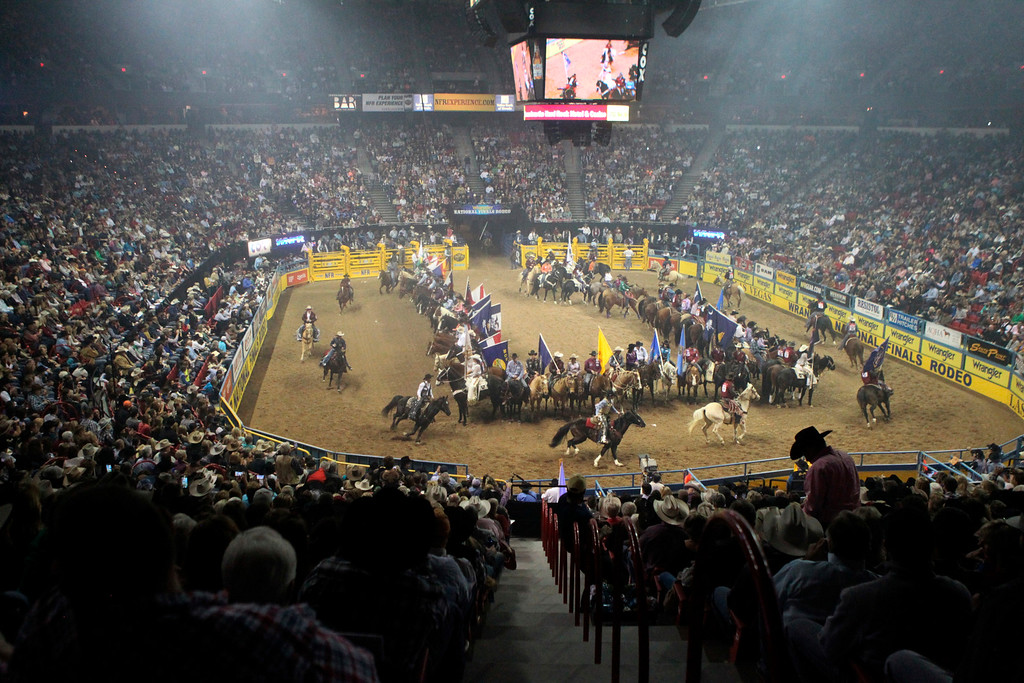 . Competitors are welcomed during the opening of the fourth round at the 2014 National Finals Rodeo in Las Vegas, Sunday, Dec. 7, 2014. (AP Photo/Las Vegas Review-Journal, Erik Verduzco)