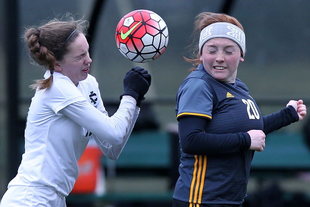 . Jillian Ramos (20), Madison Heights Bishop Foley and Annabel Geissbuhler, Cranbrook-Kingswood, go up for a header pass during varsity soccer action at Cranbrook-Kingswood Saturday, April 14, 2018. Foley blanked the Cranes 2-0. (For The Oakland Press / LARRY McKEE)