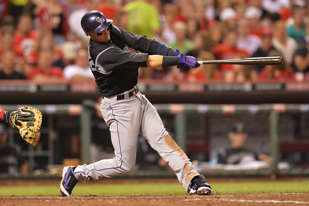 . CINCINNATI, OH - MAY 10: Troy Tulowitzki #2 of the Colorado Rockies connects for a solo home run in the sixth inning at Great American Ball Park on May 10, 2014 in Cincinnati, Ohio. Colorado defeated Cincinnati 11-2. (Photo by Jamie Sabau/Getty Images)