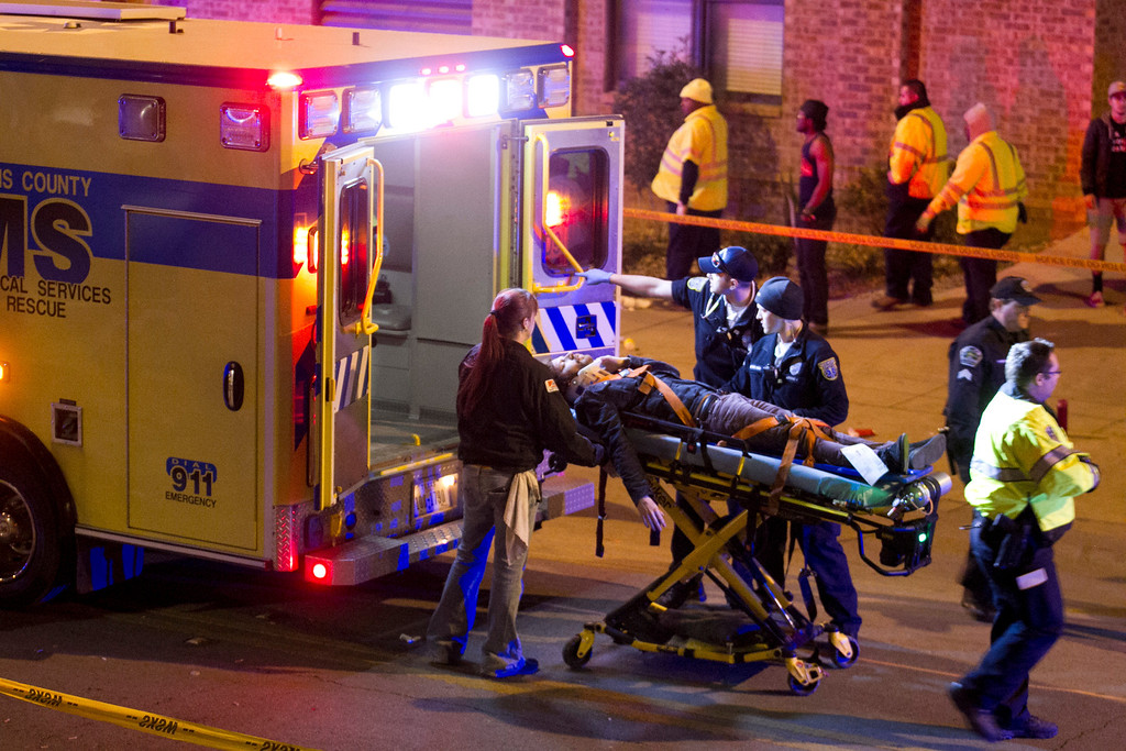 . A man is transported to an ambulance after being struck by a vehicle on Red River Street in downtown Austin, Texas, during SXSW on Wednesday March 12, 2014.  (AP Photo/Austin American-Statesman, Jay Janner)