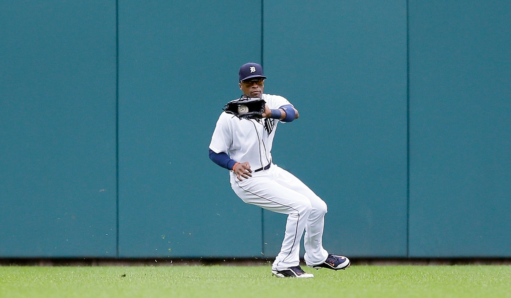. Detroit Tigers center fielder Austin Jackson prepares reaches the run scoring single hit by Cleveland Indians\' Jason Kipnis during the seventh inning in the first baseball game of a doubleheader, Saturday, July 19, 2014 in Detroit. (AP Photo/Carlos Osorio)