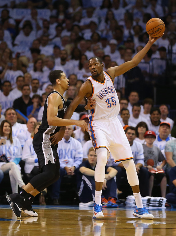 . OKLAHOMA CITY, OK - MAY 31:  Kevin Durant #35 of the Oklahoma City Thunder looks to pass the ball against Danny Green #4 of the San Antonio Spurs in the first half during Game Six of the Western Conference Finals of the 2014 NBA Playoffs at Chesapeake Energy Arena on May 31, 2014 in Oklahoma City, Oklahoma. (Photo by Ronald Martinez/Getty Images)
