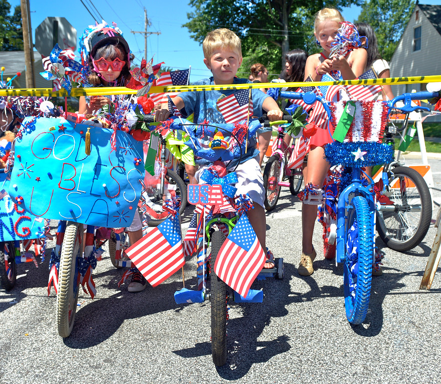 . Jeff Forman/JForman@News-Herald.com Vanessa Horn, 7, left, Connor Coonce, 5, and Erica Kirby, 9, wait to ride their decorated bicycles in the Mentor Headlands July 4th Parade.