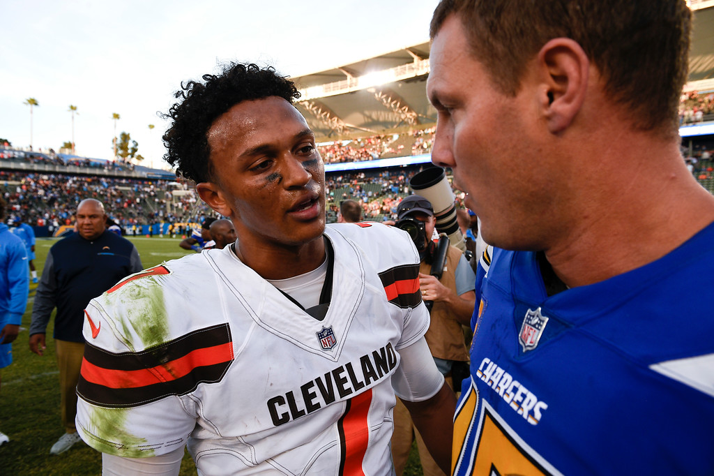 . Los Angeles Chargers quarterback Philip Rivers, right, greets Cleveland Browns quarterback DeShone Kizer after their win during an NFL football game Sunday, Dec. 3, 2017, in Carson, Calif. (AP Photo/Kelvin Kuo)
