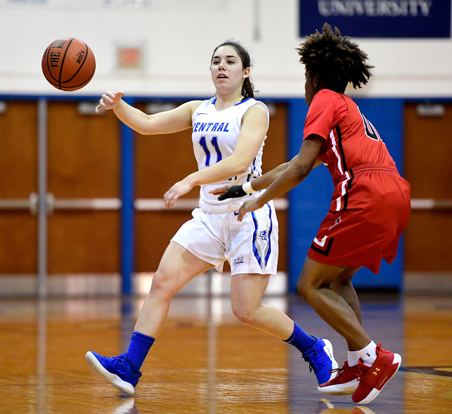 1/19/2019 Mike Orazzi | Staff CCSU's Bruna Vila Artigues (11) and Saint Francis University's Phee Allen (00) during Saturday's basketball game with CCSU in New Britain.