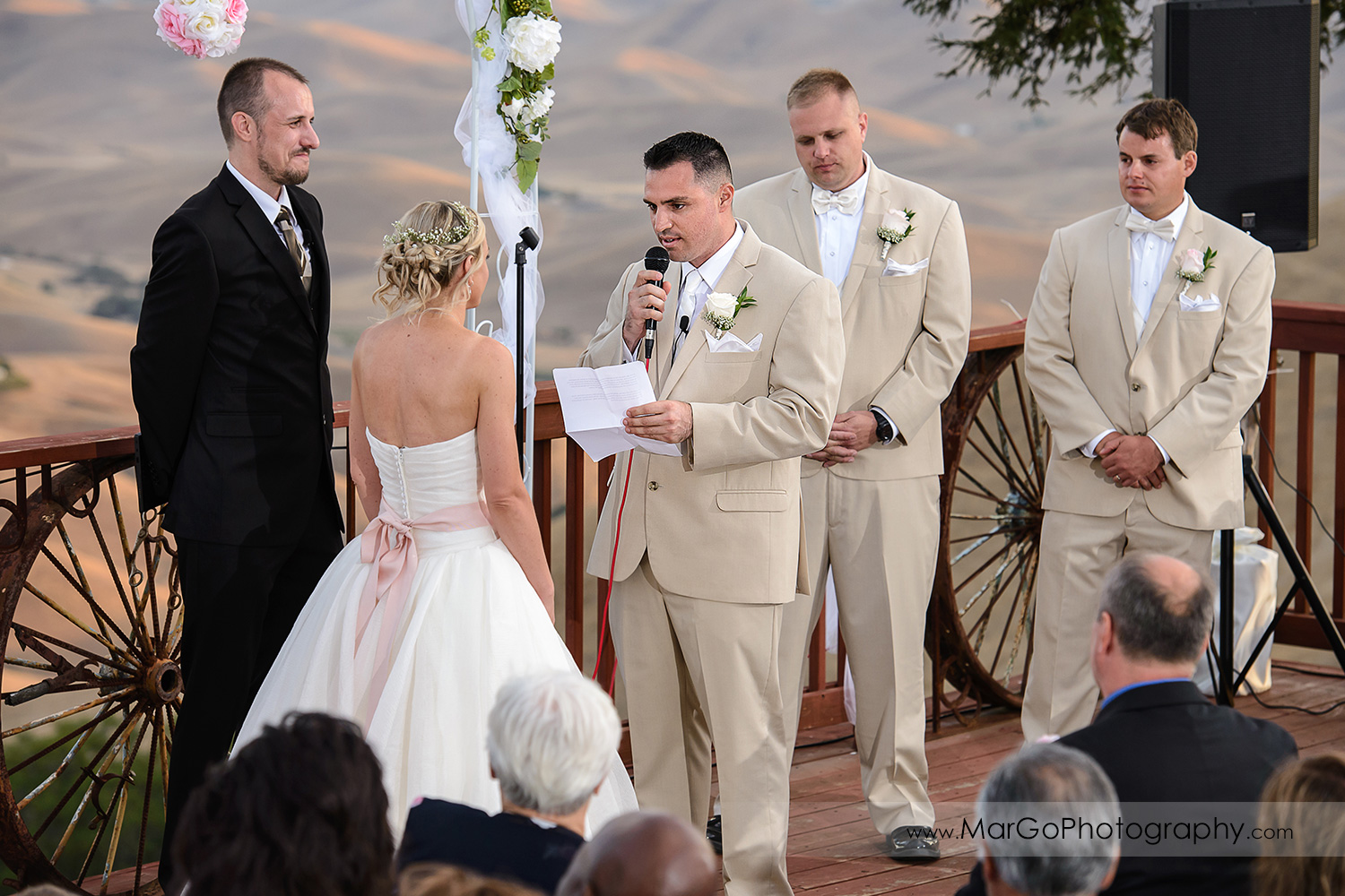 groom reading vow during backyard wedding ceremony