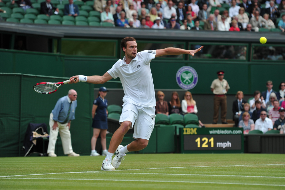 . Latvia\'s Ernests Gulbis returns against France\'s Jo-Wilfried Tsonga during their second round men\'s singles match on day three of the 2013 Wimbledon Championships tennis tournament at the All England Club in Wimbledon, southwest London, on June 26, 2013. French sixth seed Tsonga was forced to retire from his Wimbledon second round match against Gulbis with a knee injury. CARL COURT/AFP/Getty Images