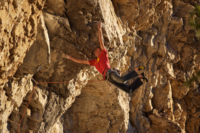 """Perfect evening light at the Notch. Derek G. sticks mandatory the jump dyno on """"Fire in the sky"""" 12b"""