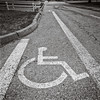 Handicapped stencil on road, Seattle, Washington, 1992,  Ilford HP5 plus.
