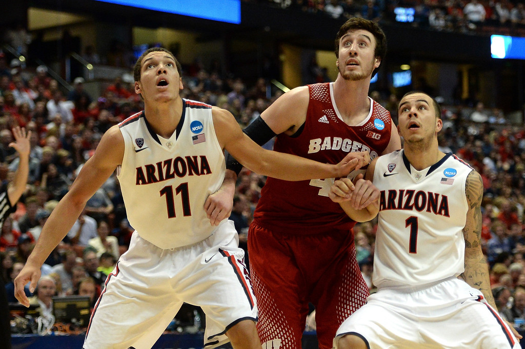 . Aaron Gordon #11 and Gabe York #1 of the Arizona Wildcats box out Frank Kaminsky #44 of the Wisconsin Badgers in the second half during the West Regional Final of the 2014 NCAA Men\'s Basketball Tournament at the Honda Center on March 29, 2014 in Anaheim, California.  (Photo by Harry How/Getty Images)