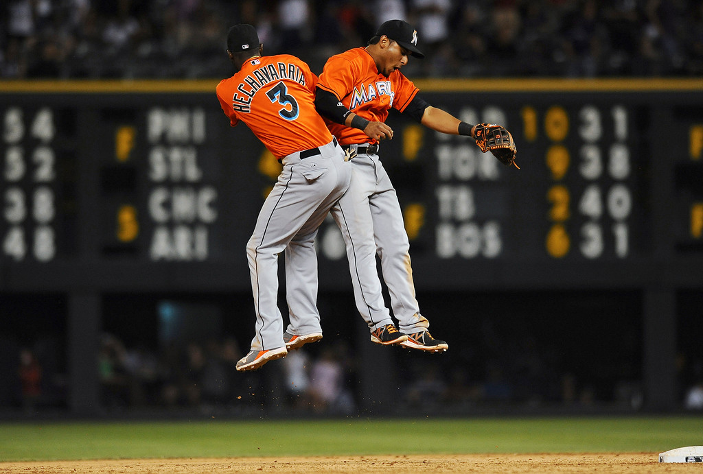 . Miami Marlins shortstop Adeiny Hechavarria, left, and second baseman Donovan Solano celebrate the Marlins\' 4-2 win over Colorado Rockies in a baseball game Tuesday, July 23, 2013 in Denver. (AP Photo/Chris Schneider)