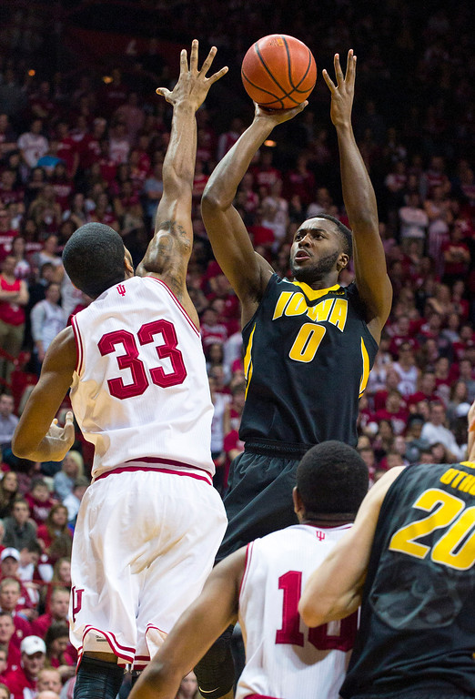 . Iowa\'s Gabriel Olaseni (0) shoots over Indiana\'s Jeremy Hollowell (33) in the first half of an NCAA college basketball game on Thursday, Feb. 27, 2014, in Bloomington, Ind. (AP Photo/Doug McSchooler)