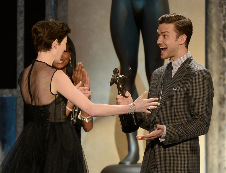 . Actor/singer Justin Timberlake (R) presents actress Anne Hathaway with the award for Outstanding Performance by a Female Actor in a Supporting Role for \'Les Miserables\' onstage during the 19th Annual Screen Actors Guild Awards held at The Shrine Auditorium on January 27, 2013 in Los Angeles, California.  (Photo by Mark Davis/Getty Images)