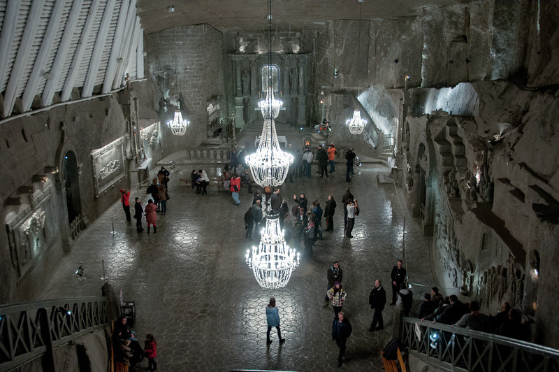 Tourists checking out St. Kinga Chapel deep within the Wieliczka Salt Mine - Poland