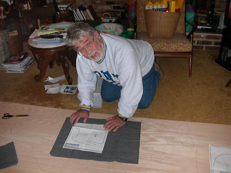 Tracing the pattern on to the plywood.