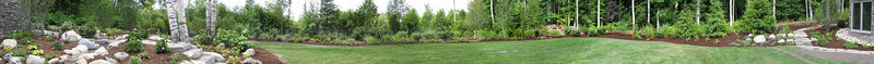 Kind of a neat panorama of backyard landscaping (taken with multiple photos and stitched together electronically)