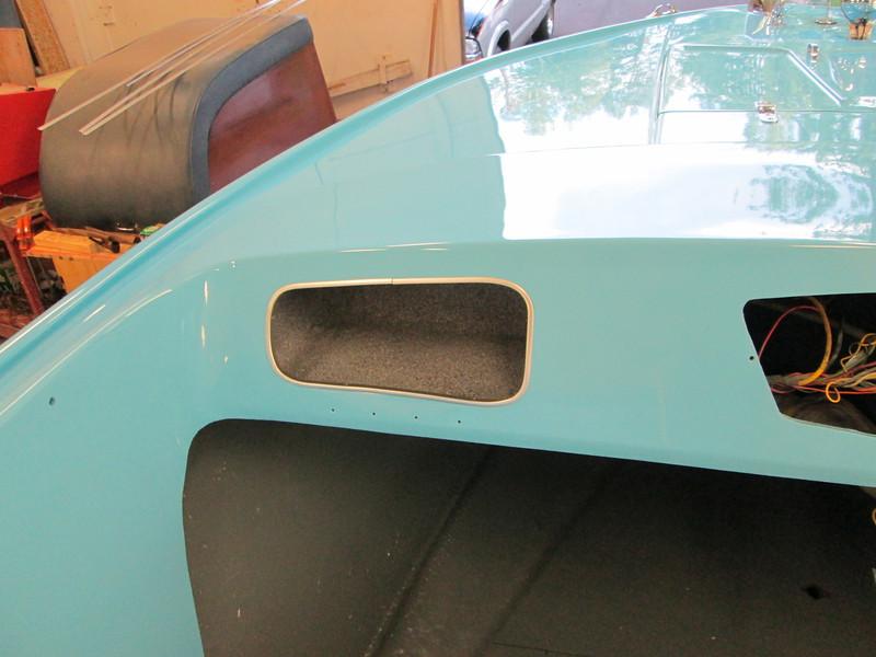New aluminum trim mounted around glove box.