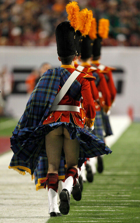 . A member of the Notre Dame Fighting Irish band has his kilt blow up before the start of the NCAA BCS National Championship college football game in Miami, Florida January 7, 2013. REUTERS/Jeff Haynes