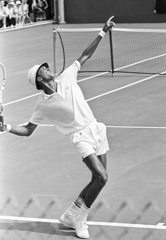 . Arthur Ashe, Richmond, Virginia, became the first African American to play on an American Davis Cup team in Denver, Colorado on Sept. 15, 1963. Ashe won his singles match against Orlando Bracamonte, of the Venezuelan Davis Cup team, 6-1, 6-1, 6-0. The American Davis Cup team made a complete sweep of the matches winning all five. The games were played at the Cherry Hills Country Club, Denver, Colorado. (AP Photo/Robert Scott)