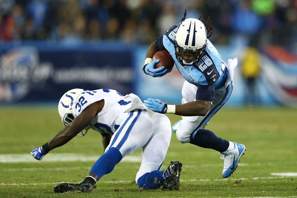 . NASHVILLE, TN - NOVEMBER 14:  Chris Johnson #28 of the Tennessee Titans carries the ball against the defense of  Cassius Vaughn #32 of the Indianapolis Colts in the second quarter at LP Field on November 14, 2013 in Nashville, Tennessee.  (Photo by Andy Lyons/Getty Images)