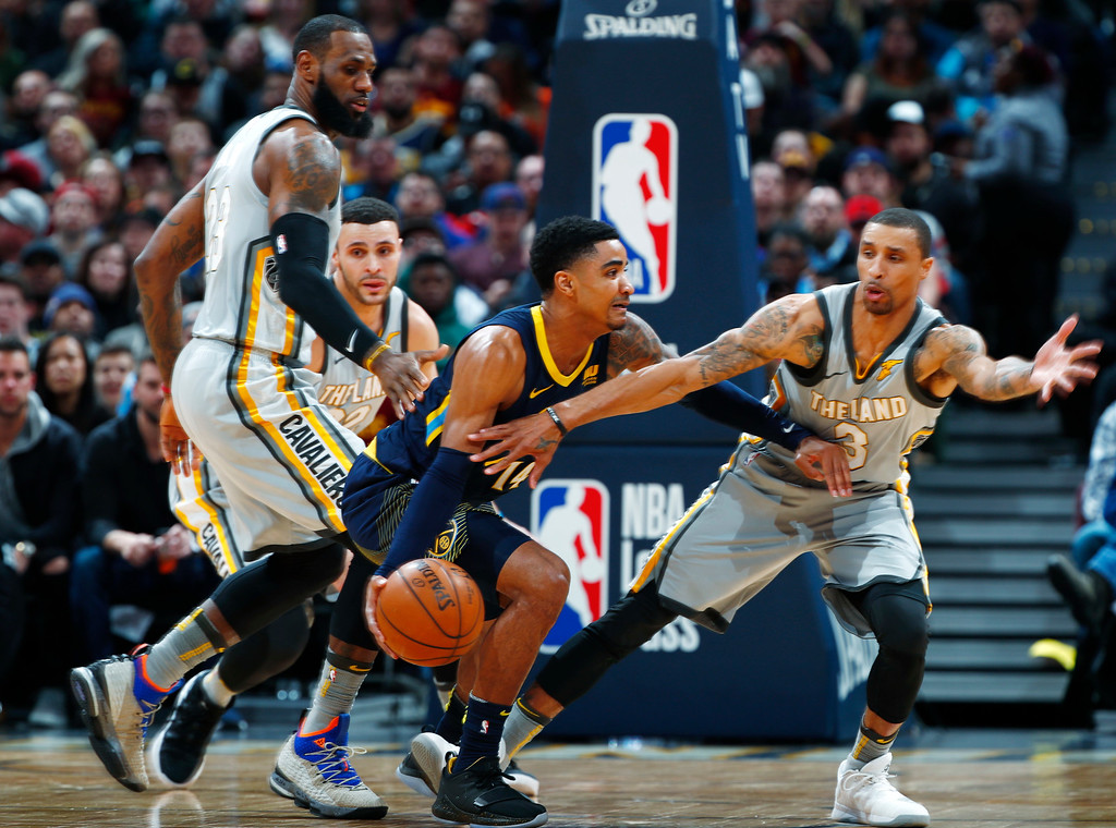 . Denver Nuggets guard Gary Harris, center, drives between Cleveland Cavaliers forward LeBron James, left, and guard George Hill during the first half of an NBA basketball game Wednesday, March 7, 2018, in Denver. (AP Photo/David Zalubowski)