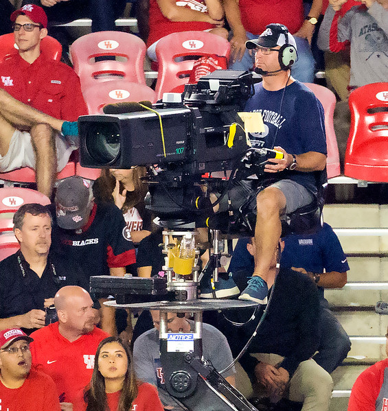The ESPN TV camera whizes along the sideline.