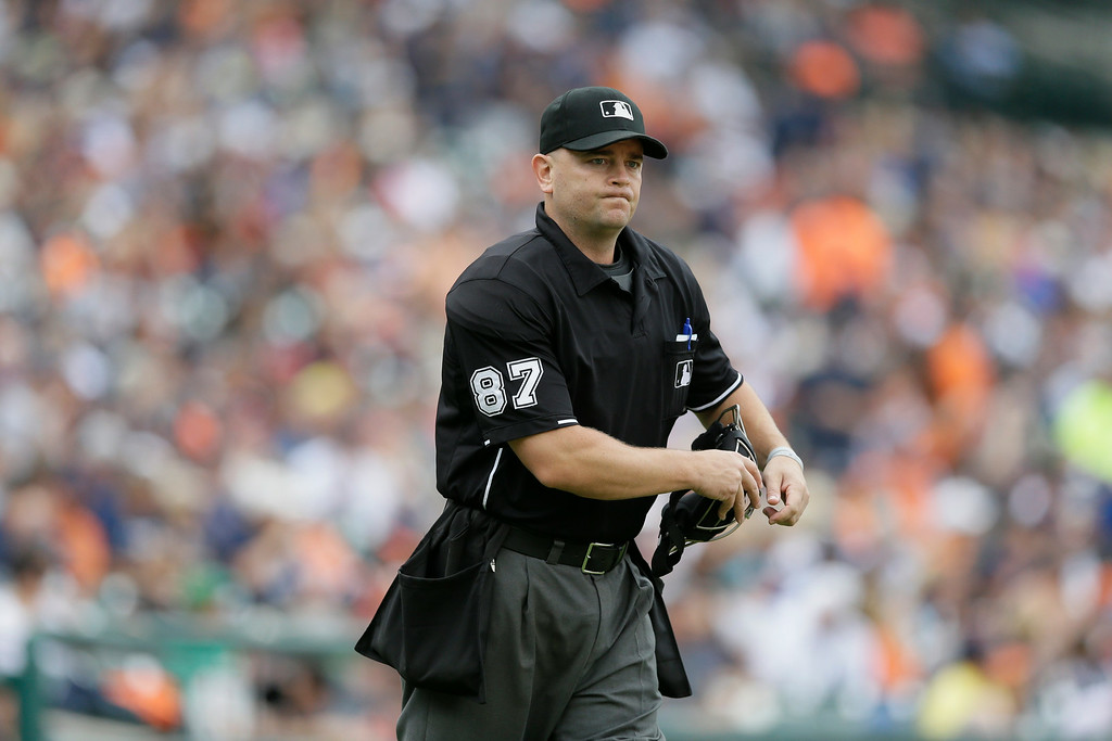 . Home plate umpire Scott Barry is seen during the first inning in the first baseball game of a doubleheader between the Detroit Tigers and the Cleveland Indians, Saturday, July 19, 2014 in Detroit. (AP Photo/Carlos Osorio)