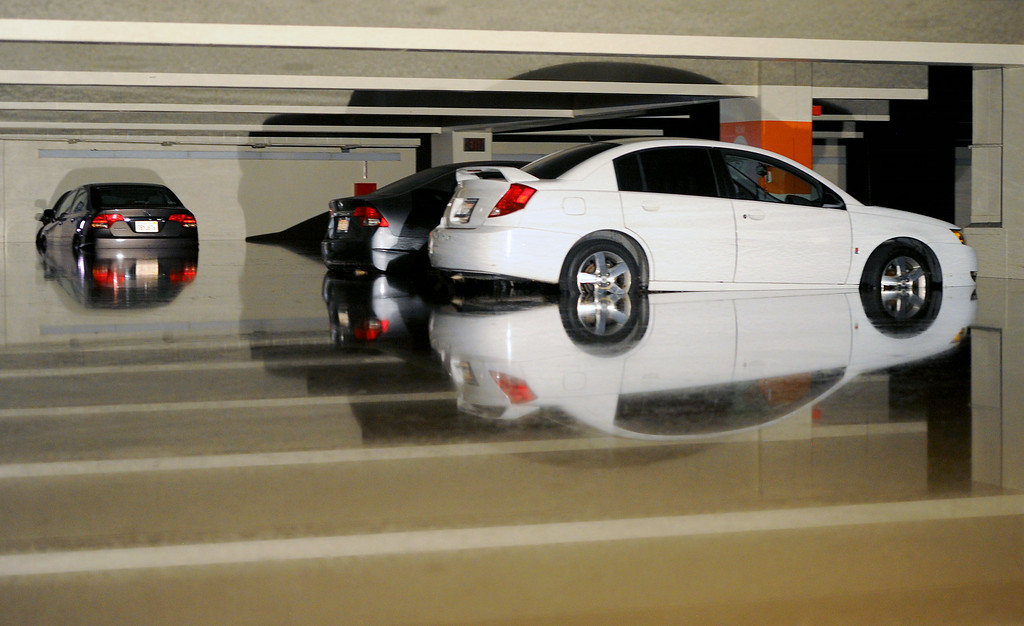 . Cars in sit in water at parking structure 7 at UCLA, Wednesday, July 30, 2014. (Photo by Michael Owen Baker/Los Angeles Daily News)