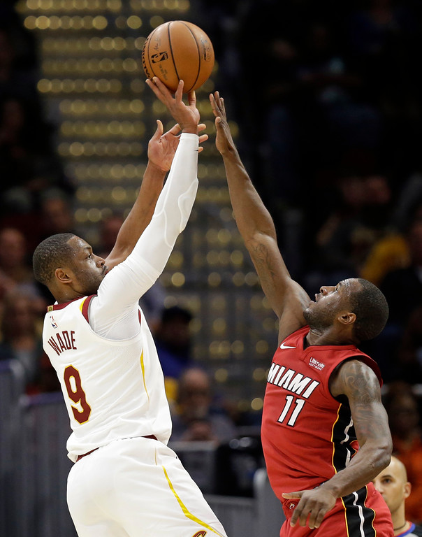 . Cleveland Cavaliers\' Dwyane Wade (9) shoots over Miami Heat\'s Dion Waiters (11) in the second half of an NBA basketball game, Tuesday, Nov. 28, 2017, in Cleveland. The Cavaliers won 108-97. (AP Photo/Tony Dejak)