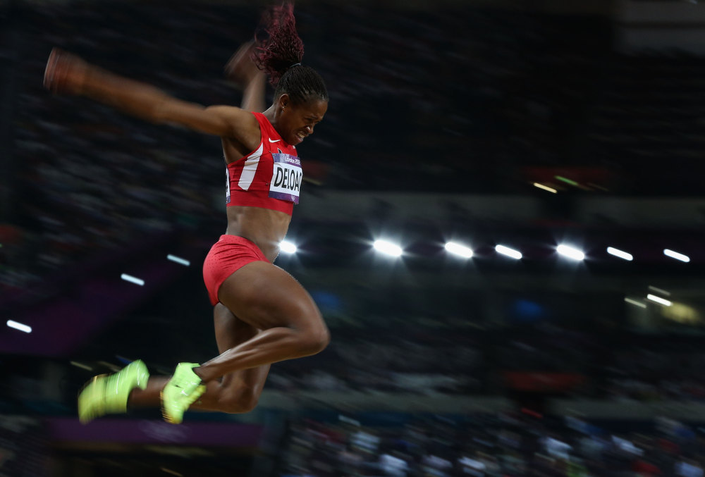 ". Janay Deloach of the United States competes in the Women\'s Long Jump Final on Day 12 of the London 2012 Olympic Games  at Olympic Stadium on August 8, 2012 in London, England. ""Olympics 2012\"" ranked as Google\'s third most searched trending event of 2012. (Photo by Clive Brunskill/Getty Images)"