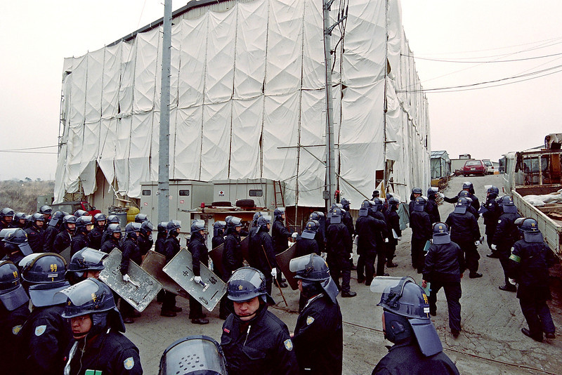 . Riot policemen surround the main commune of the doomsday cult Aum Supreme Truth at Kamikuishiki village, 100km west of Tokyo, on March 23, 1995. Huge amounts of chemicals have already been taken away from Kamikuishiki in four previous days of searching. The cult is implicated in the March 20 gas attack on the Tokyo subway. YOSHIKATSU TSUNO/AFP/Getty Images